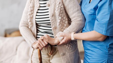 Helping hand... care home staff looking after one resident