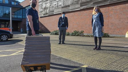 Mathew Boomer delivering laptops from Norfolk County Council to Ben Lynch, IT manager, and Jackie Ap