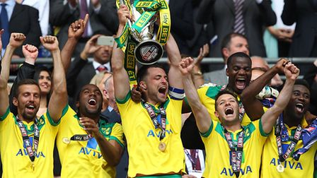 Russell Martin lifts the Championship play-off final trophy at Wembley that secured Premier League f