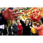 Giant puppets and schoolchildren parading on Angel Hillto launch Bury St Edmunds Festival in 2002