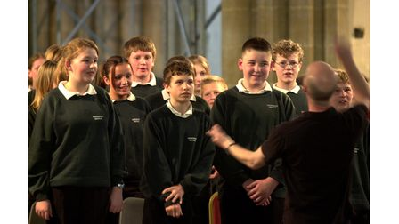 Children performing inSt Edmundsbury Cathedral during their Bury Festival world premiere concert with the Britten...