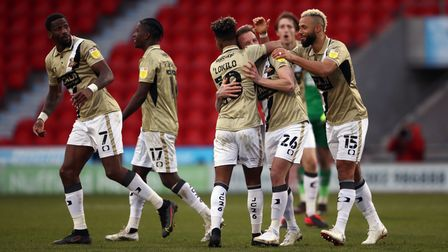 Doncaster Rovers' James Coppinger celebrates scoring their sides third goal to level the score at 3-