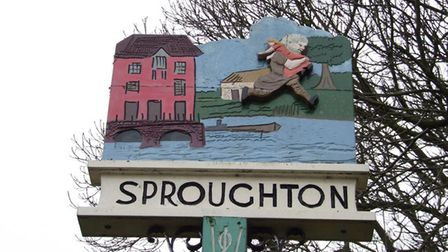 The colourful Sproughton village sign shows the wild man leaping over the river.