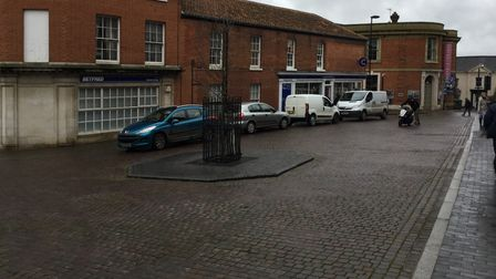 cars being parked in pedestrian areas