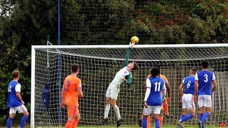 Jake Alley making a save while between the posts for Ipswich