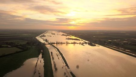 Jason Cox captured drone footage of flooded fields at Sutton Gault just before sunset following recent flooding.