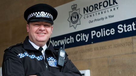 Nathan Clark stands with his arms folded at Norwich police station.