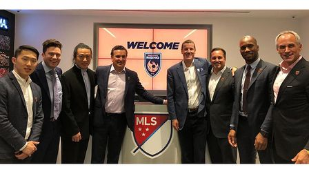 Brett Johnson, centre right, with Phoenix Rising and MLS officials in 2018