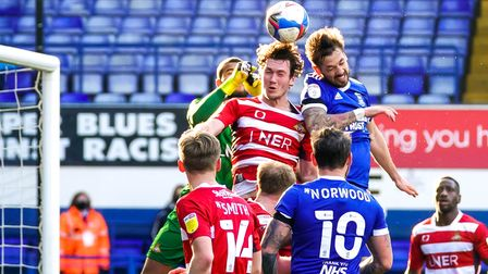Luke Chambers battles to get his head to the ball.