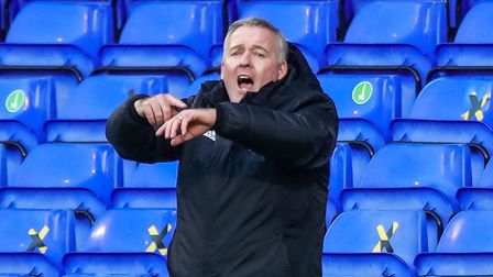 Town manager Paul Lambert reminding then referee to keep an eye on his watch in the final moments of