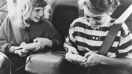 Playing on a Nintendo Game Boy in the car in 1992