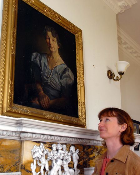 EADT-NEWS Pic Simon Parker Mary Skelcher of The National Trust at Sutton Hoo with the portrait o