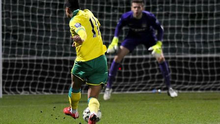 Josh Murphy shoots and scores past former Canaries academy team-mate Angus Gunn within the first min