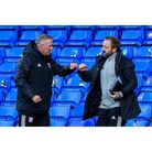 Town manager Paul Lambert and first team coach Matt Gill bump fists at the end of the game against D