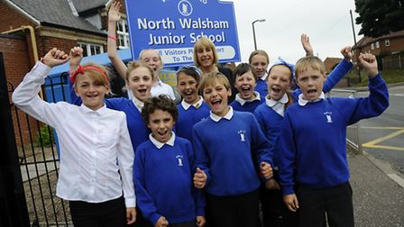 Head teacher Clare Fletcher and pupils of North Walsham Junior School celebrate their recent Ofsted