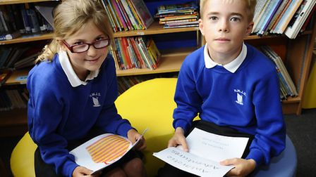 Chloe Lawrence and William Jones of North Walsham Junior School with their award winning stories in