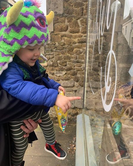 Ely resident Finn spotting one of the rocks in the Eel Catcher's Daughter shop window.
