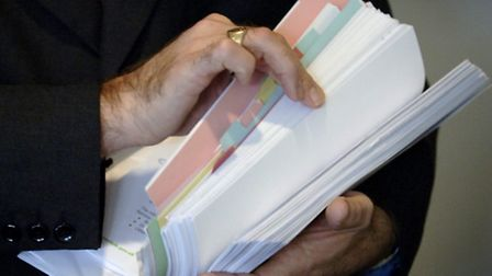 A dossier of confidential council papers detailing the issues surrounding the deficit in the adult e