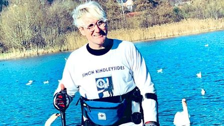 Simon Kindleysides, from Blofield, who is paralysed, after walking 125 miles in a robotic suit throughout February 2021...