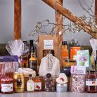 A hamper of British produce including beer, spirits, jams, candles, granola and cured meats
