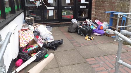 Bin bags filled with unwanted items have piled up outside of EACH charity shop in Diss.