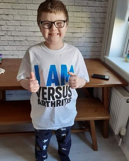 nine-year old wearing his official Versus Arthritis T'shirt