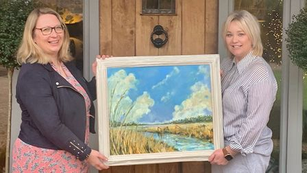 Judi Newman, development director of St Elizabeth Hospice, and Lucky Ticket's Emma Lloyd with theDavid Gillingwater painting