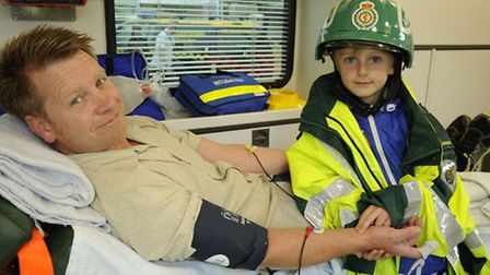 Cromer Ambulance Open Day in aid of Nelson's Journey charity. Pictured is Chris and Jacob Minns.Pict