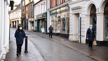 People wear masks while walking through the Thouroughfare in Woodbridge, at the beginning of January 2021