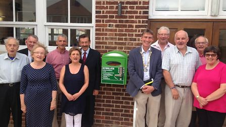 Sprowston town councillors outside the Diamond Centre next to one of the town's two new defibrillato