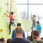 Children tackle a climbing wall at Future Youth Zone, Dagenham