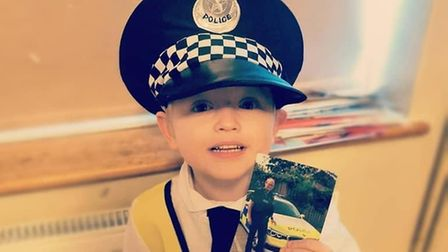 Budding police officer Caleb, aged 4, dressed as his road cop grandad for World Book Day.