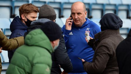 Paul Cook faces the press after the defeat at Gillingham