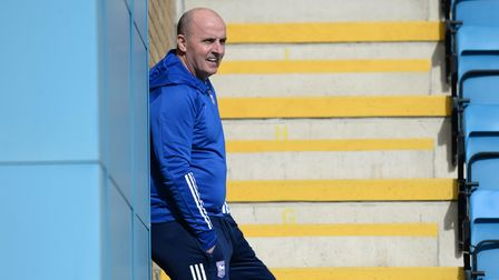 Paul Cook watches the warm-up at Gillingham