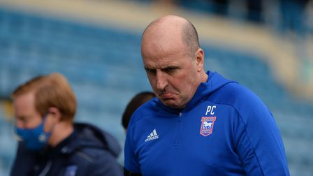 Paul Cook ponders defeat in his first game in charge after the game at Gillingham