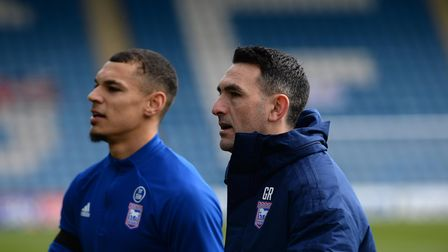 Gary Roberts with Kayden Jackson during the warm-up at Gillingham