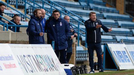 Paul Cook during his first game in charge at Gillingham talking to Matt Gill and Paul Roberts