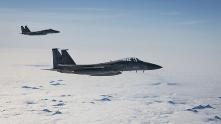 U.S. Air Force F-15C Eagles assigned to the 493rd Fighter Squadron at RAF Lakenheath flying over the Scottish mountains