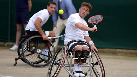 Alfie Hewett in action on day Thirteen of the Wimbledon Championships at the All England Lawn Tennis