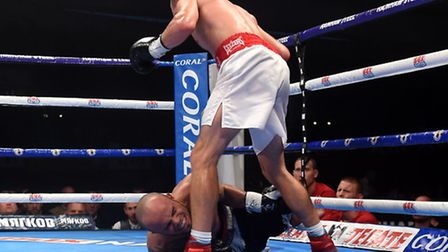 England's Liam Walsh knocks down fights Brazil's Isaias Santos Sampaio at the Manchester Velodrome,