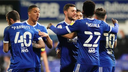 Town players celebrate with James Wilson, after he had headed them level.