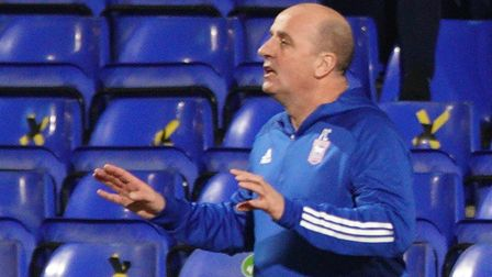 Town manager Paul Cook with instructions to his players.