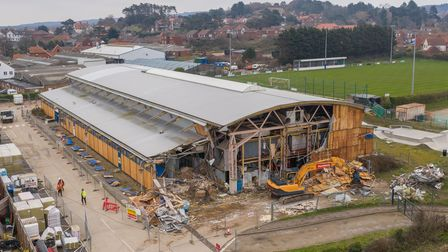 Sheringham's Splash leisure centre is being demolished next to the site where its replacement building is going up.