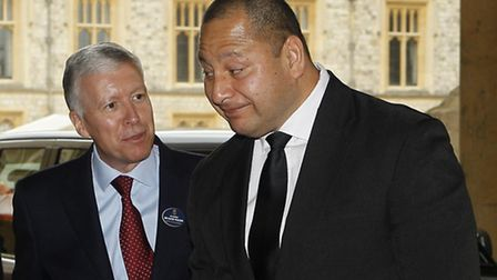 King Tupou VI of Tonga is greeted by The Master of the Household Air Marshal Sir David Walker (left)