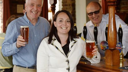 Emily Nudd and her father Dennis Nudd at the Trafford Arms, Norwich with landlord Chris Higgins. The