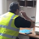 A Fenland Council staff member takes a rapid Covid-19 test.