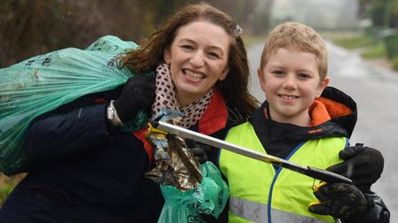 James Naylor, eight, and his mum, Vanessa, out walking and picking up litter in Saham Toney. Picture