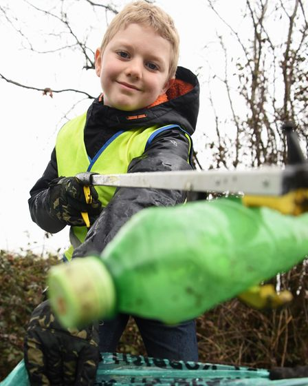 James Naylor, eight, out walking and picking up litter in Saham Toney. Picture: DENISE BRADLEY