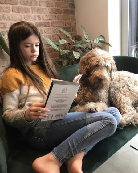 The Shade pupil reading at home for World Book Day