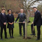Caption: Felsted School pupils and Headmaster Chris Townsend plant a fruit tree as part of the Boarding Schools...